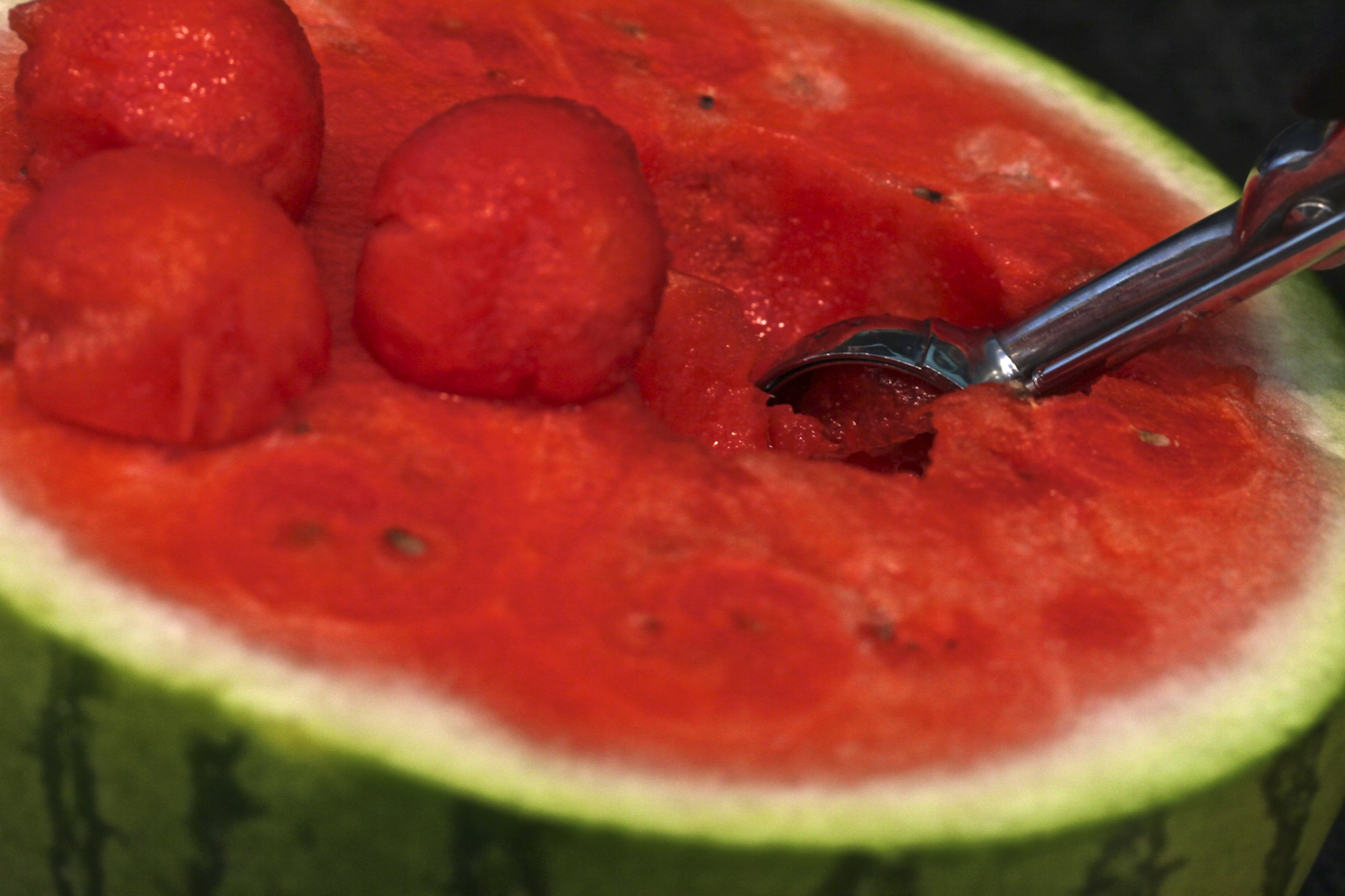 Scoop out watermelon and the cantaloupe using a melon baller. Carve ...